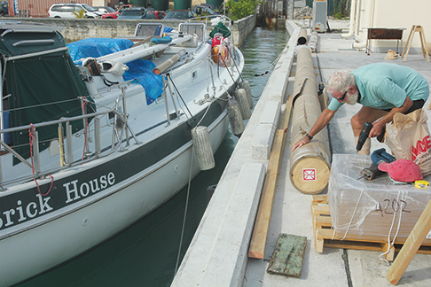 Our friend John unpacks the new mast.