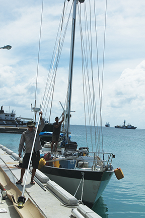 23) Using a halyard, we lift the roller furler into position.