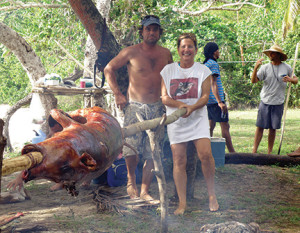 Cheryl and Otis cooking a pig for Jenny's birthday