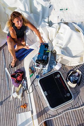 Amanda with Sailrite machine on deck  (photo by Tor Johnson)