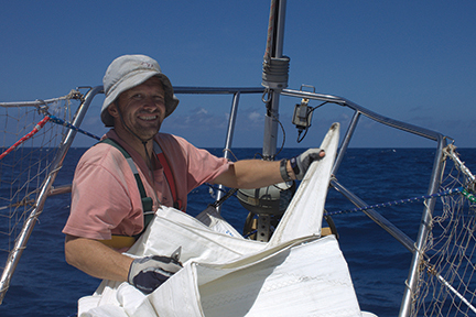 Markus swaps our heavy-weather  foresail for the twin genoa