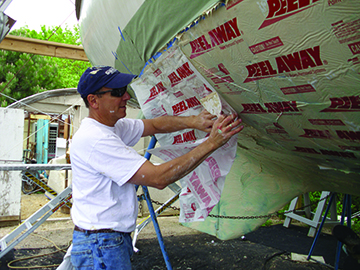 Covering Stripper with Peel Away sheeting
