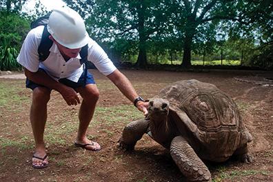 The author's husband Joseph, greeting one of the elder Giant Aldabran tortoises