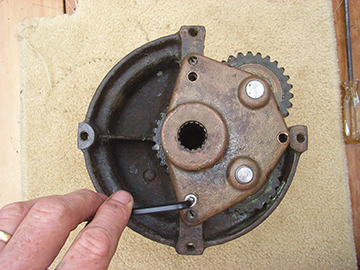 Unscrew the bottom plate to expose the gears.