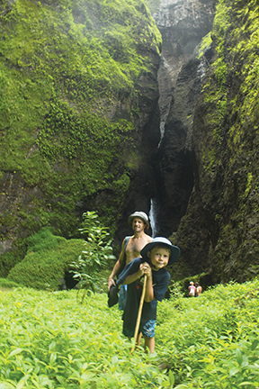 Marcus, the author's husband and son Nicky visit the queen of the cascades, Nuku Hiva's Vaipo waterfall
