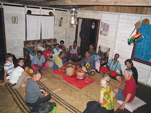 Kava night with Fijian friends and other voyagers, Seth and Ellen far left