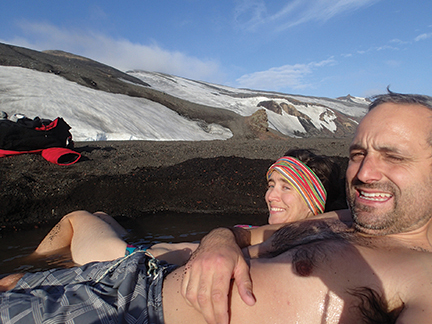 Laura and Federico relax in thermal waters at Whaler's Bay on Deception Island, their first stop after crossing the Drake.