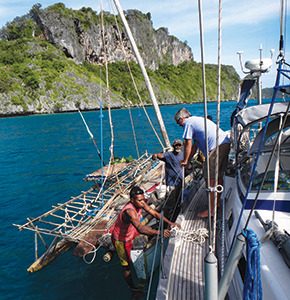 A sailau arrives to trade at Panasia