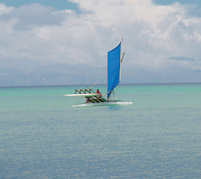Flying the outrigger across Ninigo Lagoon