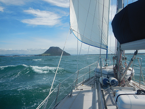 Approaching Mount Maunganui and Tauranga, a good base for boat work and inland travel.