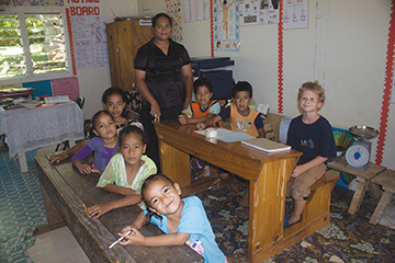 Nicky sits among his classmates at the one room schoolhouse on Lape Island