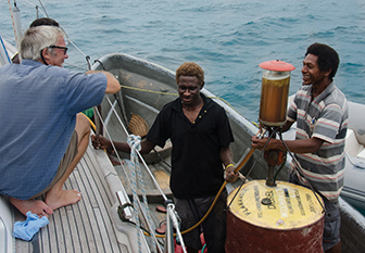 Malcolm did not trust Jim with his pump so brought out the fuel himself to the anchorage in Kavieng