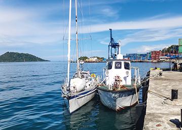 Tenaya tied to the old Coast Guard boat in Jayapura, Indonesia