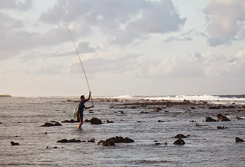 Sam fishing for grouper at sunset