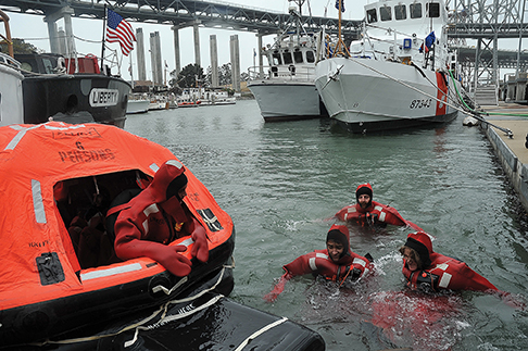 SAN FRANCISCO – Sea scouts and adult leaders participate in cold-water survival training led by a petty officer of Coast Guard Station San Francisco, Saturday, Oct. 23, 2010, during the annual Sea Scout Safety at Sea event held on Yerba Buena Island. The Coast Guard hosted the event at Sector San Francisco where more than 400 sea scouts and adult leaders participated in hands-on safety, shipboard damage control, fire fighting and law enforcement trainings over the weekend. U.S. Coast Guard photo by Petty Officer 3rd Class Erik Swanson.