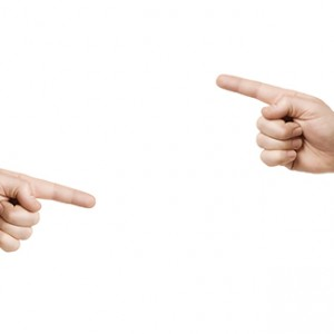 An image of two hands pointing to something