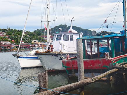 Tenaya tied to the old Coast Guard boat at Bitang Dock 9