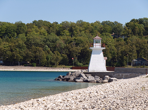 Lighthouse in Lion´s Head port on Huron lake, Canada