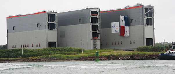 Above; the gates to the new Panama Canal locks waiting to be installed on the Atlantic side. They are 95 feet tall and weigh 3,319 tons, below; Captain Morgan (left) watching on the port wing, Advisor Howard (center) and Captain Larry (right) of the Kadey Krogan 42, Hobo leaving a lock