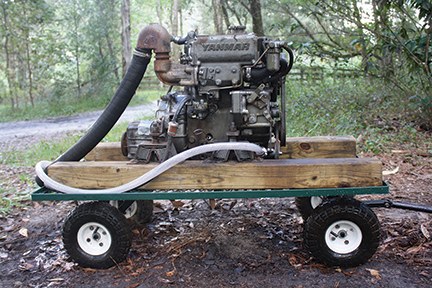 A practice engine: this 2 cylinder Yanmar diesel is mounted on a garden cart for convenience