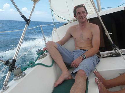 The author, Daniel Shea, enjoying the first sail on Cruzan Time