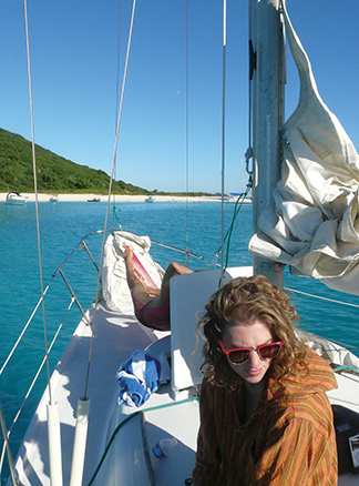 Co-owner Rachel, relaxes onboard while anchored off St. Croix's Buck Island