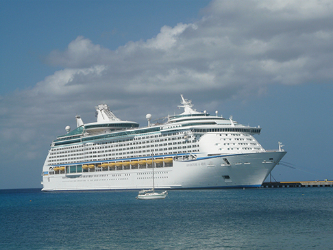 The 27-foot Cruzan Time dwarfed by a cruise ship off Frederiksted on St. Croix's west end
