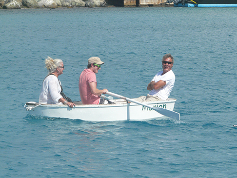 The author inexpertly rows fellow co-owners in Cruzan Time, Amanda Brilliante and Carsten Breuer, shortly after the purchase of their rowing dinghy, Marion