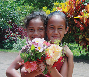 Young Marquesan girls showing off
