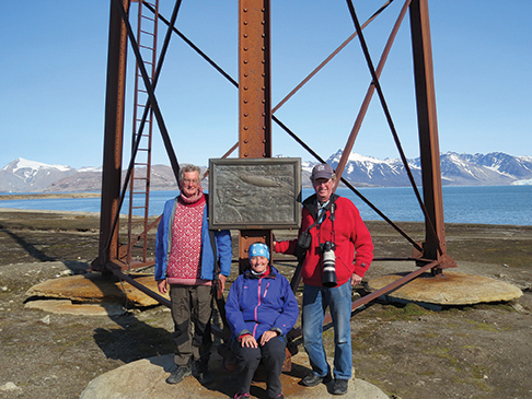 Hookon, Judith and Odd  in front of the mast to twhich Amundsen's airship was tied in 19926, Ny Alesund