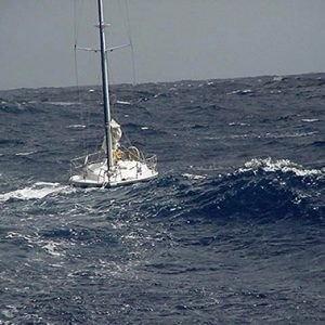 AT SEA (Oct. 6)--The Coast Guard Cutter Cormorant battled 10 to 12 foot seas and winds 20 to 25 knots to tow in this disabled sailboat whose engine was inoperable and also had a broken rudder.  U.S. COAST GUARD PHOTO