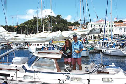 Amanda and John with gifts from Horta's mayor, Jose Dias, Vela's enthusiastic harbormaster