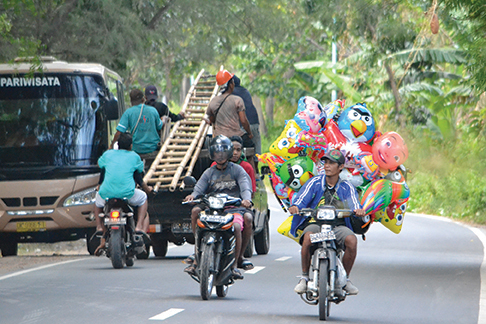 Overloaded motorcycles in Gili Ayer
