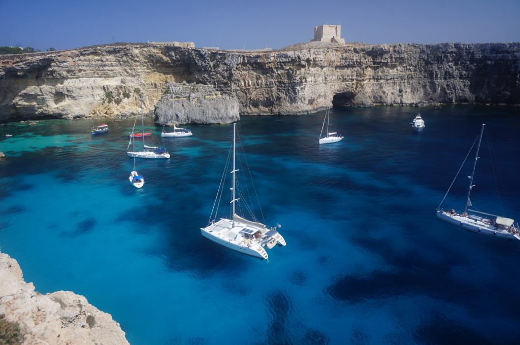 Thanks to Vic Pipinich and Becky Callison for this stunning shot of their Lagoon 47 Mira anchored at Comino Island, Malta under the Santa Maria Watchtower, which was built in 1618!