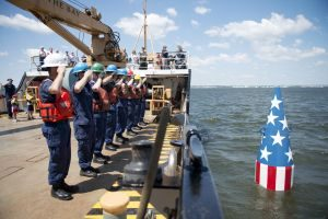 "Crewmembers aboard U.S. Coast Guard Cutter James Rankin, a 175-foot buoy tender homeported in Baltimore, render a salute after setting the Francis Scott Key buoy in Baltimore, Md., June 6, 2016. The buoy marks the spot where the ship carrying Francis Scott Key, the author of ""The Star-Spangled Banner"", was anchored during the bombardment of Fort McHenry during the War of 1812. (U.S. Coast Guard photo by Petty Officer 3rd Class Jasmine Mieszala)"