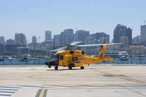 A yellow MH-60 Jayhawk helicopter arrives at Coast Guard Sector San Diego in celebration of 100 years of Coast Guard aviation on July 21, 2016. The paint scheme is a throwback to the colors of the helicopters used in the late 1940s and early 1950s. (U.S. Coast Guard photo by Petty Officer 3rd Class Joel Guzman/released)