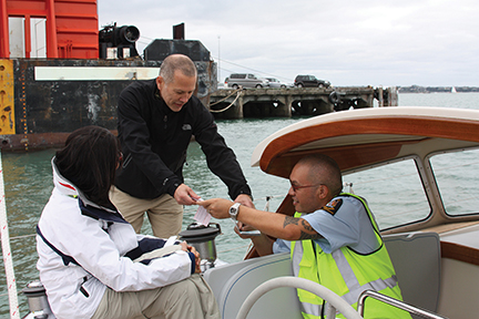 Bob gives his John Hancock to a customs officer wile departing New Zealand