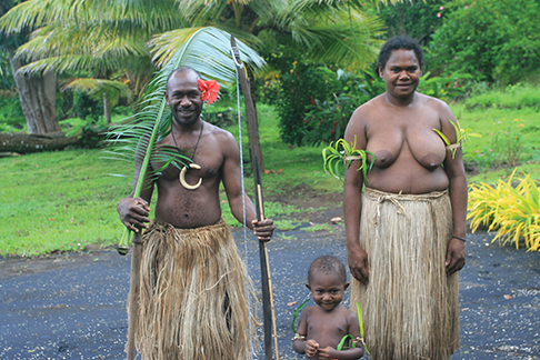 Chief Kerely Malau, his wife, Elizabeth, and son, Dudley, wearing traditional costumes