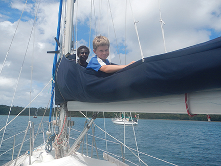 Nicky shows a local boy his favorite hideaway aboard Namani