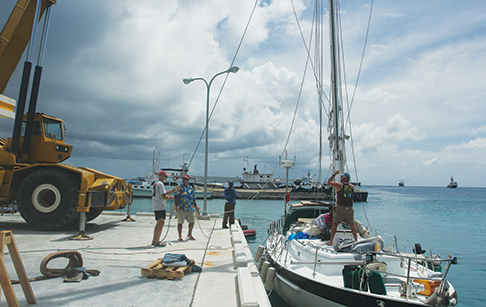 Lifting the mast into place.