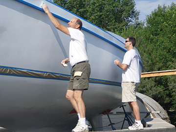 Pete and Alex conduct tack rag wipe and inspection prior to spraying topcoat.