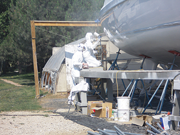 Standing at an angle ahead of the spray gun allows one to see the gloss flow.