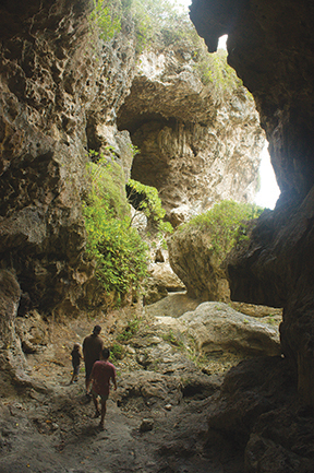 """Exploring Avaiki caves on one of the many island """"sea tracks"""""""