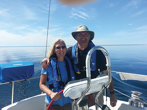 Cindy with her husband Michael at the helm