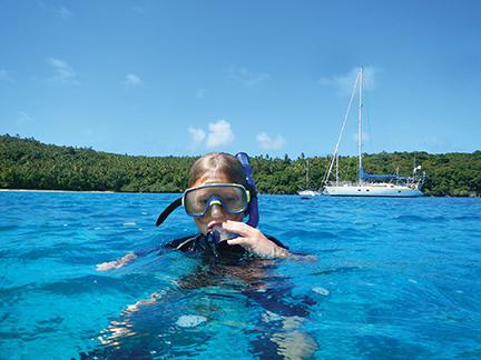 Nicky snorkels among the plump, indigo starfish of Port Morelle