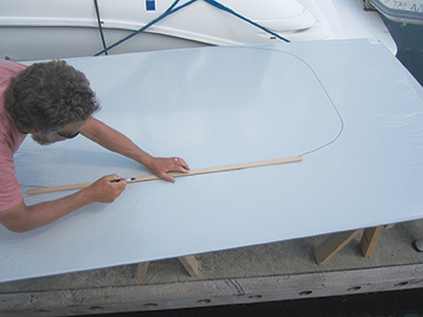 Mike finishing the outline of the hardtop template before cutting the StarBoard