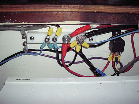 Powerr and water pump wiring. Relay provides for turning off the refrigeration from the nav station.