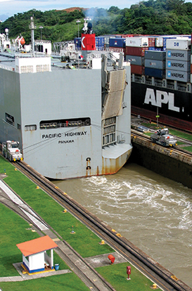 The car carrier Pacific Highway, barely fitting into the Mira Flores locks