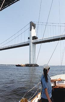 Ellen steers Nahma under the Annapolis bridge