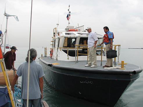 The advisor arrives on the pilot boat